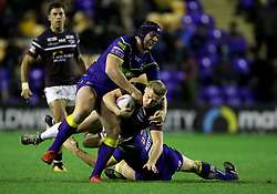 Leeds Rhino's Brad Dwyer is tackled by Warrington's Chris Hill and Ben Westwood during the Betfred Super League match at the Halliwell Jones Stadium, Warrington.