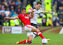 Nottingham Forest's Eric Lichaj (left) and Derby County's David Nugent battle for the ball during the Sky Bet Championship match at Pride Park, Derby.