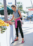 Silvina picking out some beautiful fruit at the Farmers Market on South Beach.