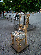Ghetto Heroes Square, Krakow, Poland, with its 33 memorial chairs made of cast iron and bronze. The chairs symbolize the tragedy of the Polish Jews in the Ghetto.<br /> It was in Zgody Square that selections would be made; decisions for life or death