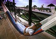 Relaxing in a locally made hammock at Casa Sandra on Isla de Holbox, Mexico.