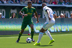 May 13, 2018 - Portland, OR, U.S. - PORTLAND, OR - MAY 13:  Portland Timbers defender Alvas Powell one on one with Seattle Sounders defender Nouhou Tolo during the Portland Timbers 1-0 victory over the Seattle Sounders on May 13, 2018, at Providence Park in Portland, OR. (Photo by Diego Diaz/Icon Sportswire) (Credit Image: © Diego Diaz/Icon SMI via ZUMA Press)