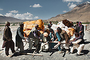 Afghani men coming to do business on the weekly Tajikistan market, at the town of Ishkashim.