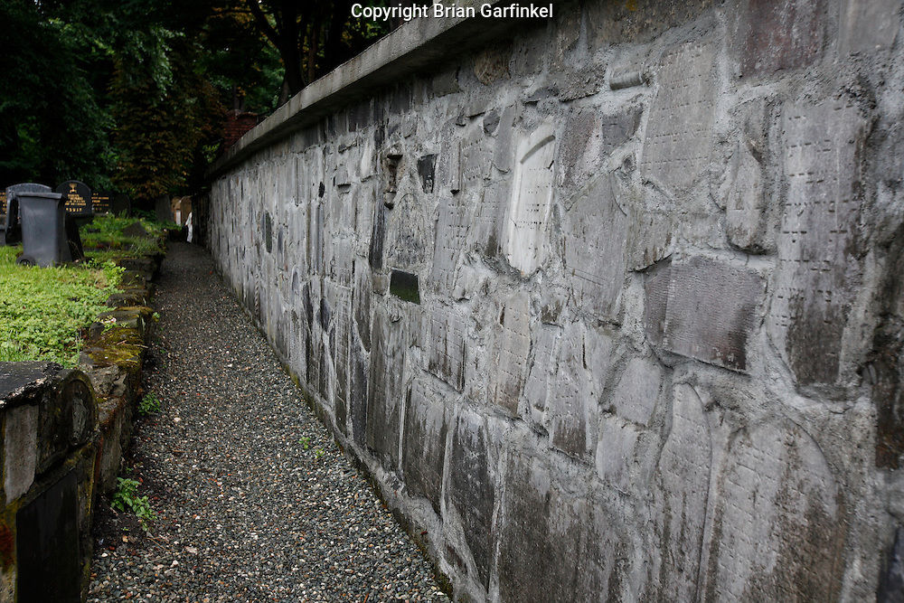 """A wall is made with old grave stones in the """"New"""" Jewish cemetery in Krakow, Poland on Monday July 4th 2011.  (Photo by Brian Garfinkel)"""