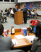 Newly elected Board member Robert Nunez, right, is sworn into office by Assemblyman Kansen Chu during the Milpitas Unified School District Board of Education Administration of the Oath of Office ceremony at the Board of Education in Milpitas, California, on December 9, 2014. (Stan Olszewski/SOSKIphoto)