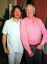 Left to right, JULIAN LLOYD WEBBER and SIR TIM RICE at a party in London on 8th September 1999.MWA 34