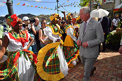 The Prince of Wales at a market in St. George's during a one day visit to the Caribbean island of Grenada.