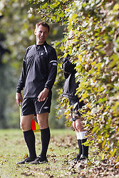 © Licensed to London News Pictures . 28/09/2014 . Birmingham , UK . Health Secretary JEREMY HUNT serves as linesman during the match , consulting with a mentor . Hunt , who is newly qualified as a linesman , received support from a mentor during the match . Conservative Party vs Journalists football match at a Birmingham University football pitch , at the start of the conference . The 2014 Conservative Party Conference in Birmingham . Photo credit : Joel Goodman/LNP