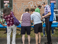May 27, 2019 - Urbandale, Iowa, U.S - People line up for food at a Memorial Day barbecue hosted by US Senator Cory Booker (D-NJ) at his Iowa campaign office. Sen. Booker is running to be the Democratic nominee for the US Presidency. Iowa traditionally hosts the the first selection event of the presidential election cycle. The Iowa Caucuses will be on Feb. 3, 2020. (Credit Image: © Jack Kurtz/ZUMA Wire)