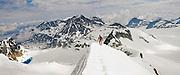 Climber Obadiah Reid downclimbs the NE Arete of Wedge Mountain in Garibaldi Provincial Park, British Columbia, Canada on June 14, 2009.