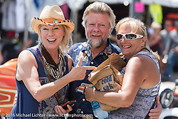 Donna Maupin and Arlin Fatland of Two-Wheelers with Melissa Shoemaker at the Harley-Davidson Editors Choice Custom Bike Show on Main Street during the annual Sturgis Black Hills Motorcycle Rally.  SD, USA.  August 8, 2016.  Photography ©2016 Michael Lichter.