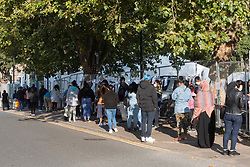 © Licensed to London News Pictures. 19/09/2020. London, UK. Queues of people outside a walk-in Covid-19 testing centre Edmonton, North London. The UK government is considering rationing Coronavirus tests for the general public has seen an increased demand for Covid-19 tests in recent days and a rise of over 3,500 daily. The British Prime Minister Boris Johnson has stated a second wave of Covid-19  was inevitable. Photo credit: Ray Tang/LNP