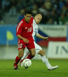 TEPLICE, CZECH REPUBLIC - Wednesday, April 30, 2003: Czech Republic's Patrik Gedeon and Turkey's Bastürk during a friendly match at the Teplice Stadion Na Stinadlech. (Pic by David Rawcliffe/Propaganda)