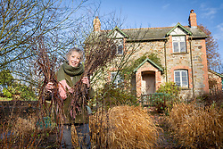 Carol Klein clearing the borders at Glebe Cottage in winter