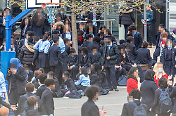 © Licensed to London News Pictures. 31/03/2021. London, UK. School children at Pimlico Academy in London take part in a mass walk-out in protest over their school's new uniform policy, following claims it is discriminatory and racist. Photo credit: Alex Lentati/LNP<br /> <br /> *WARNING* PICTURE PIXELATED TO HIDE CHILDREN'S IDENTITIES. Pictures of Children in school playground*