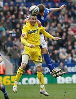 Photo: Steve Bond/Richard Lane Photography. Leicester City v Cardiff City. Coca Cola Championship. 13/03/2010. Kevin McNaughton (front) and Andy King in the air