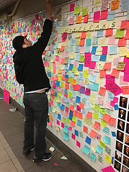 Anti-Trump Post Its adorn the walls of Union Square Subway Station in New York City.