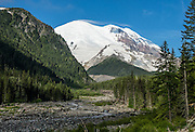 Lenticular clouds form over Mount Rainier (14,411 feet) as seen from White River Campground in Mount Rainier National Park, Washington, USA.