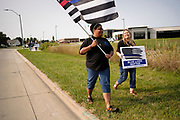 """19 SEPTEMBER 2020 - ALTOONA, IOWA: WHITNEY SMITH-MCINTOSH, left, and CONNIE WRIGHT lead a march of pro-police ralliers near the police station in Altoona, a suburb of Des Moines. About 30 people attended an """"Uplifting Our Police"""" rally to show support for not just Altoona police, but law enforcement across the country.    PHOTO BY JACK KURTZ"""