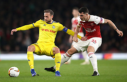 FC BATE Borisov's Ihar Stasevich (left) and Arsenal's Granit Xhaka battle for the ball during the UEFA Europa League round of 32 second leg match at the Emirates Stadium, London.