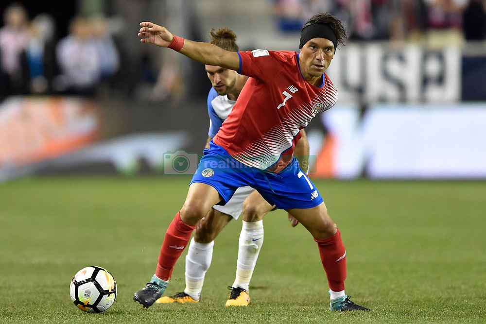 September 1, 2017 - Harrison, New Jersey, U.S - Costa Rica midfielder CHRISTIAN BOLAÃ'OS (7) shields the ball from USMNT defender GRAHAM ZUSI (19) during a World Cup Qualifier at Red Bull Arena in Harrison New Jersey Costa Rica defeats USA 2 to 0 (Credit Image: © Brooks Von Arx via ZUMA Wire)