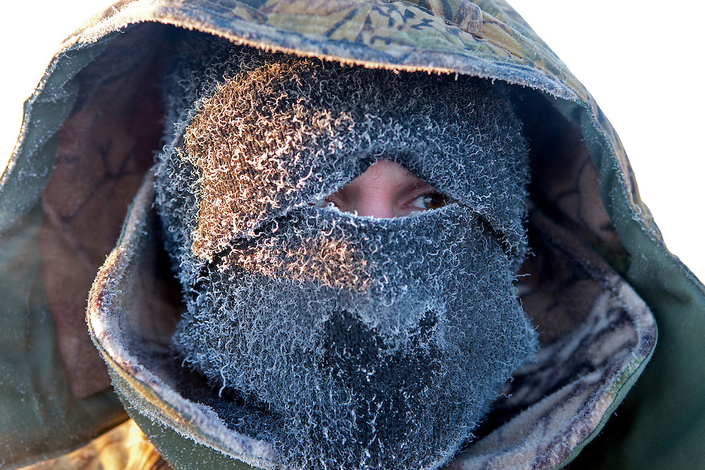 The Pole of Cold - Portrait of a man protecting himself against the extrem cold of the Oymyakon region close to the village of Tomtor. The area is extremely cold during the winter. Two towns by the highway, Tomtor and Oymyakon, both claim the coldest inhabited place on earth (often referred to as -71.2°C, but might be -67.7°C) outside of Antarctica. The average temperature in Oymyakon in January is -42°C (daily maximum) and -50°C (daily minimum). The images had been made during an outside temperature in between -50°C up to -55°C. Tomtor, Jakutien, Yakutia, Russian Federation, Russia, RUS, 19.01.2010