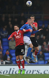 Bristol City's Aden Flint and Bristol City's Marlon Pack challenge Oldham Athletic's William Gros for the ball in the air  - Photo mandatory by-line: Dougie Allward/JMP - Mobile: 07966 386802 - 03/04/2015 - SPORT - Football - Oldham - Boundary Park - Bristol City v Oldham Athletic - Sky Bet League One