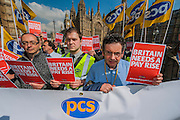 The PCS union shows the government the red card as part of a protest campaign to point out that Britain Needs a Pay Rise. Westminster, London, UK, 01 April 2014. Guy Bell, 07771 786236, guy@gbphotos.com
