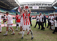 Photo: Rich Eaton.<br /> <br /> Grimsby Town v Cheltenham Town. Coca Cola League 2. Play off Final. 28/05/2006. Cheltenham captain John Finnegan shows off the trophy to the fans after his sides victory and promotion to league 1