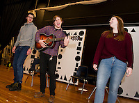 """Brad Dutton, Dan Pinkham-Breslin and Christina Dutton rehearse """"A Big Life"""" scene in the student run production of """"A Fever Dream of Creativity"""" an improv and sketch show with the Players Comedy Club at Winnisquam Regional High School on Wednesday afternoon.  (Karen Bobotas/for the Laconia Daily Sun)"""