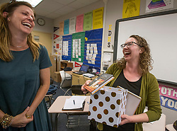 May 2, 2017 - Placentia, California, USA - Tiffany Badger, right, shares a laugh with  Dana Armstrong, as she opens a gift after being surprised with a 2018 Teacher of the Year award in Westminster, California, on Tuesday, May 2, 2017. ..Badger, a high school English teacher at El Dorado High School, is one of six teachers who were surprised with the honor by county superintendent of school Dr. Al Mija?res. ..(Photo by Jeff Gritchen, Orange County Register/SCNG) (Credit Image: © Jeff Gritchen, Jeff Gritchen/The Orange County Register via ZUMA Wire)