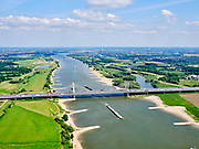 Nederland, Gelderland, gemeente Beuningen; 14–05-2020; Tacitusbrug over rivier de Waal. Tuibrug naast de oude (bestaande) Brug bij Ewijk. Autosnelweg A50.<br /> Tacitus bridge over the river Waal. Cable-stayed bridge next to the old (existing) Bridge at Ewijk.<br /> luchtfoto (toeslag op standaard tarieven);<br /> aerial photo (additional fee required)<br /> copyright © 2020 foto/photo Siebe Swart