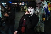 New York, NY - 31 October 2019. the annual Greenwich Village Halloween Parade along Manhattan's 6th Avenue. A reveler costumed as Charlie Chaplin.