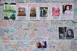 Tributes and missing posters are left on a wall near Latimer Road, close to Grenfell Tower in west London after a fire engulfed the 24-storey building on Wednesday morning.