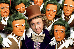 GENE WILDER, (born Jerome Silberman, June 11, 1933 - August 28, 2016) was an American stage and screen comic actor, screenwriter, film director, and author. He was known best for the lead role in the 1971 film 'Willy Wonka in Willy Wonka & the Chocolate Factory,' and the Mel Brooks comedies 'Blazing Saddles', and 'Young Frankenstein', which Wilder co-wrote, garnering the pair an Academy Award nomination for Best Adapted Screenplay. Wilder died at age 83 from complications from Alzheimer's disease. PICTURED: GENE WILDER as Willy Wonka, with extras playing Oompa Loompas, in a scene from the 1971 film 'Willy Wonka and the Chocolate Factory,' based on the children's classic by Roald Dahl. (Credit Image: © Moviestore/Entertainment Pictures via ZUMA Press)