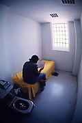 An in-custody juvenile in a cell at the Atlanta Fulton County Juvenile Detention Center, Atlanta, GA.