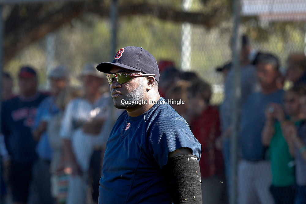 February 19, 2011; Fort Myers, FL, USA; Boston Red Sox first baseman David Ortiz stretches during spring training at the Player Development Complex.  Mandatory Credit: Derick E. Hingle