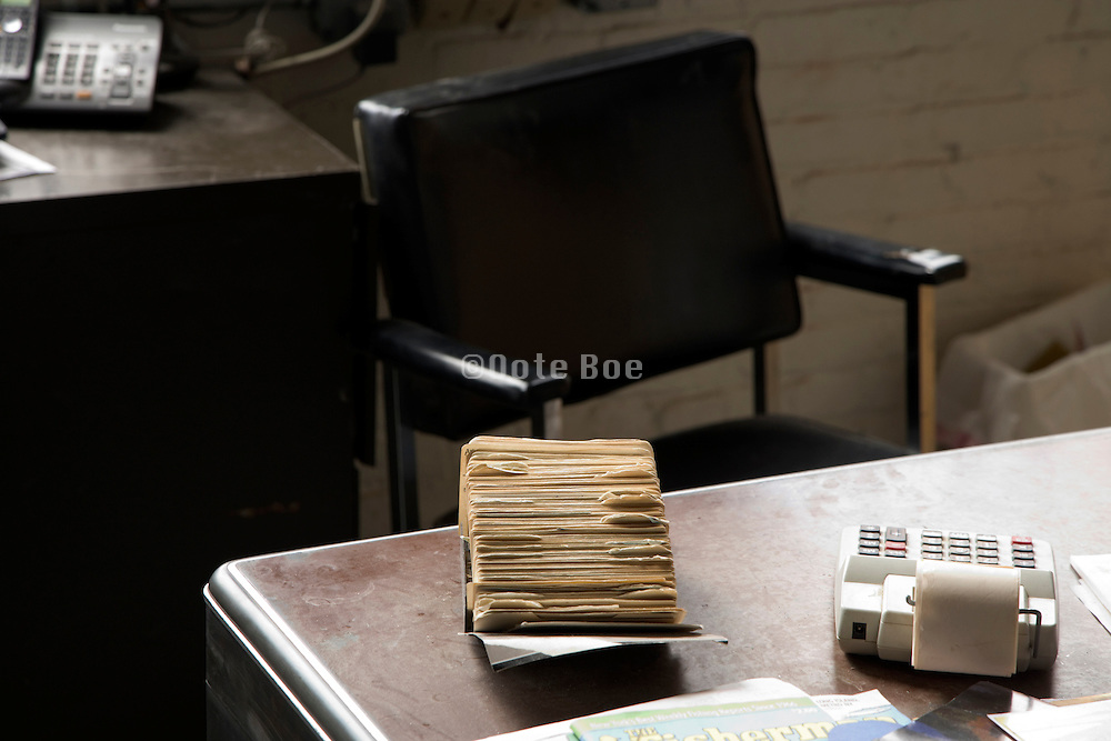 old style chair and desk with address card filing system in office and a teller