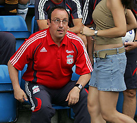 "Photo: Paul Thomas.<br /> Crewe Alexandra v Liverpool. Pre Season Friendly. 22/07/2006.<br /> <br /> Liverpool manager Rafael Benitez gets ready for the match and notice's a ""passer by""."