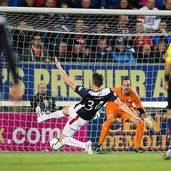 Falkirk's Owain Tudor Jones scores and own goal past keeper Jamie MacDonald. Falkirk 1 v 3 Rangers, Scottish League Cup game played 23/9/2014 at The Falkirk Stadium.