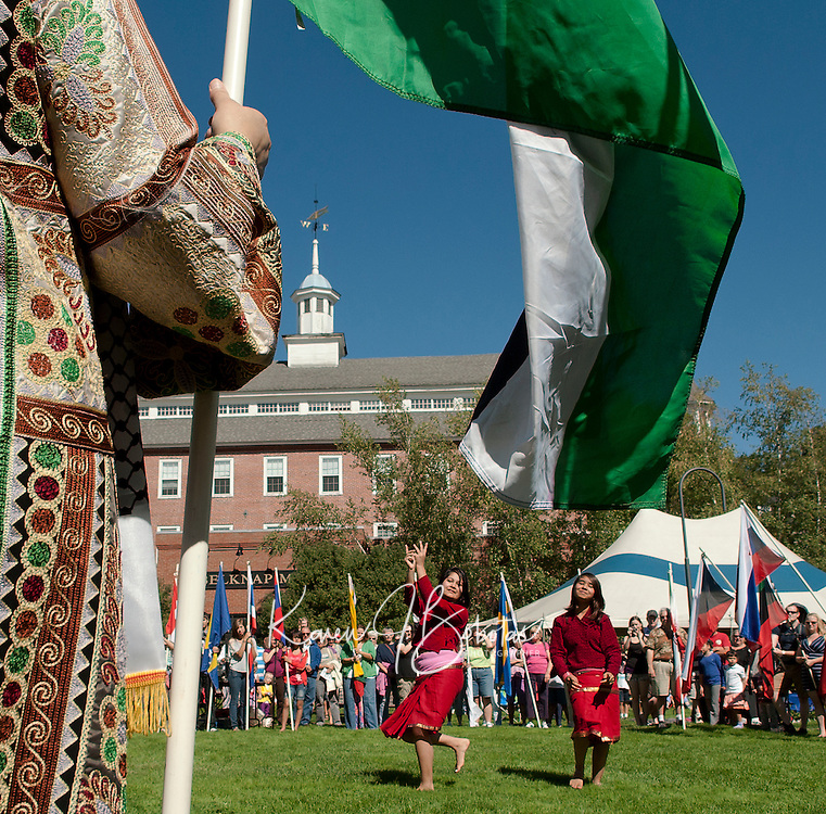 Fifty one flags representing fifty one countries encircled Champa and Anjana Dulal as they performed a traditional Nepali dance at Rotary Park Saturday to begin the 10th annual Multicultural Market Day festivities on Saturday.  (Karen Bobotas/for the Laconia Daily Sun)