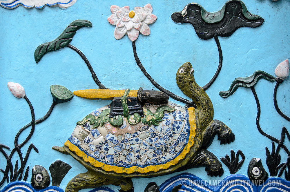 Turtle art at the Temple of the Jade Mountain (Ngoc Son Temple) on Hoan Kiem Lake in the heart of Hanoi's Old Quarter. The temple was established on the small Jade Island near the northern shore of the lake in the 18th century and is in honor of the 13-century military leader Tran Hung Dao. The artwork depicts the legend of the turtle who first gave and then took back a spiritual sword used to defeat Chinese invaders.