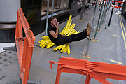 A contractor rests on foam scaffolding collars on Covid Freedom Day, the date that Prime Minister Boris Johnsons UK government has set as the end of strict Covid pandemic social distancing conditions with the end of mandatory face coverings in shops and public transport, on 19th July 2021, in London, England.