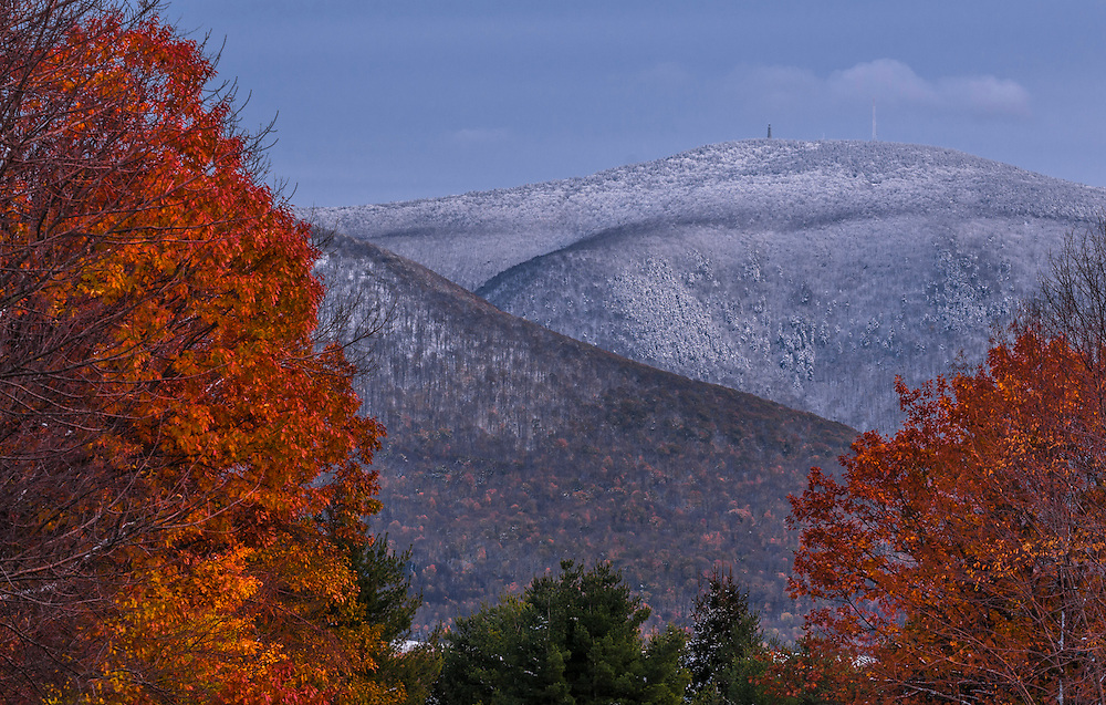 Snow on mountaintops, framed by fall foliage trees, Williamstown, MA