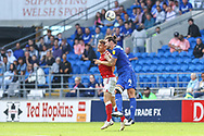 Cardiff City defender Sean Morrison (4) competes for a high ball with Bristol City's Chris Martin (9) during the EFL Sky Bet Championship match between Cardiff City and Bristol City at the Cardiff City Stadium, Cardiff, Wales on 28 August 2021.