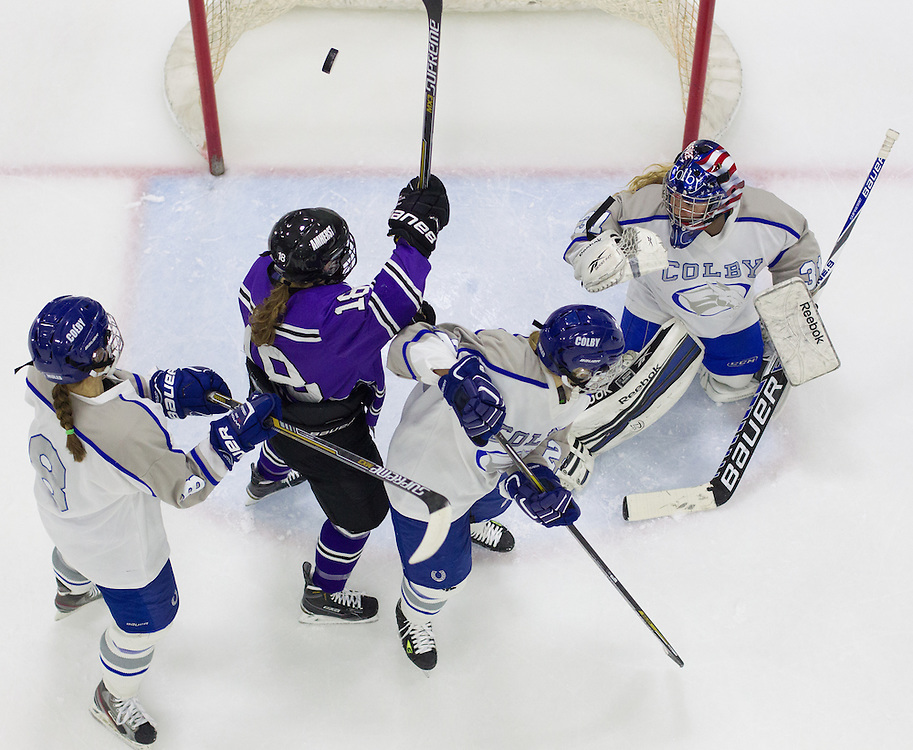 Angelica Crites, Maddie Dewhirst, and Sasha Fritts, of Colby College, in a NCAA Division III hockey game against Amherst College on January 9, 2015 in Waterville, ME. (Dustin Satloff/Colby College Athletics)