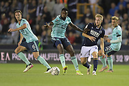 Leicester City Midfielder Wilfred Ndidi (25) and Millwall midfielder Billy Mitchell  (24)  battles for possession during the EFL Cup match between Millwall and Leicester City at The Den, London, England on 22 September 2021.