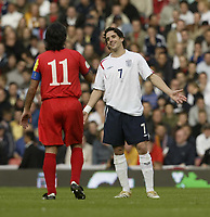 Photo: Aidan Ellis.<br /> England v Andorra. European Championships 2008 Qualifying. 02/09/2006.<br /> England's Owen Hargreaves argues a point with Andorra's Justo Ruiz