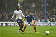 Wycombe Wanderers Forward, Fred Onyedinma (19) and Portsmouth Midfielder, Ben Close (33) during the EFL Sky Bet League 1 match between Portsmouth and Wycombe Wanderers at Fratton Park, Portsmouth, England on 22 September 2018.