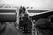 Muhammad Ali in  Dublin..1972..11.07.1972..07.11.1972..11th July 1972..Prior to his fight against Al 'Blue' Lewis at Croke Park, Dublin, former World Heavyweight Champion, Muhammad Ali arrives at Dublin Airport..The fight was part of his build up for for a championship fight against the current World Champion, 'Smokin'  Joe Frazier. Ali had been stripped of the title partly due to his refusal to join the American military during The Vietnam War,which he had opposed...Image of Muhammad Ali as he takes the time to chat with two Aer Lingus hostesses.